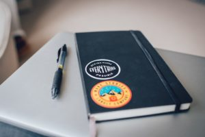 Notebook and pen how to design a logo.